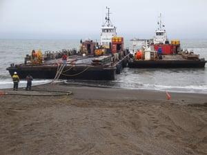 Siku and Avik pushing beach in Barrow